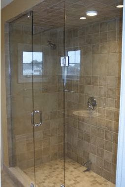 Large glass wall shower in a bathroom