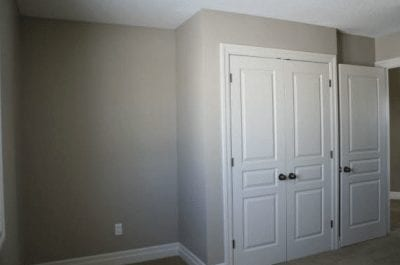 Empty room with large closet doors