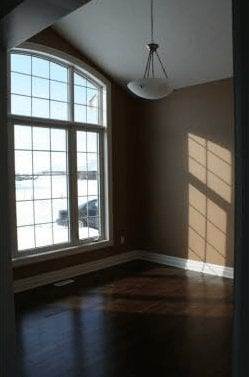 Large panel windows overlooking an empty room