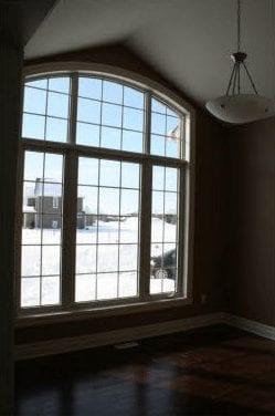 Large paneled window overlooking an empty room