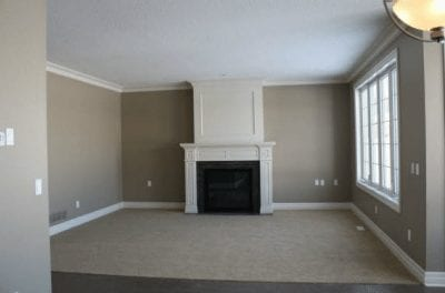 An empty great room with fireplace