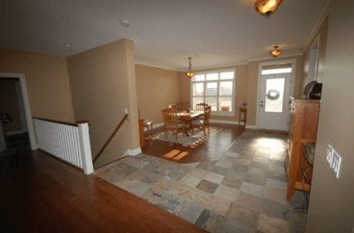 Dining area near front door entrance with stairs leading down