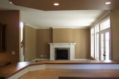 Empty great room with a large fireplace