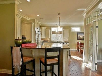 Breakfast bar overlooking a kitchen and dining area