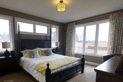 Interior view of a master bedroom with a large window