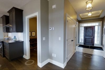 Hallway entrance leading into common area and kitchen