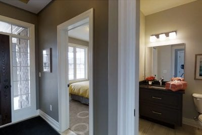 Small bathroom and bedroom near the front entrance