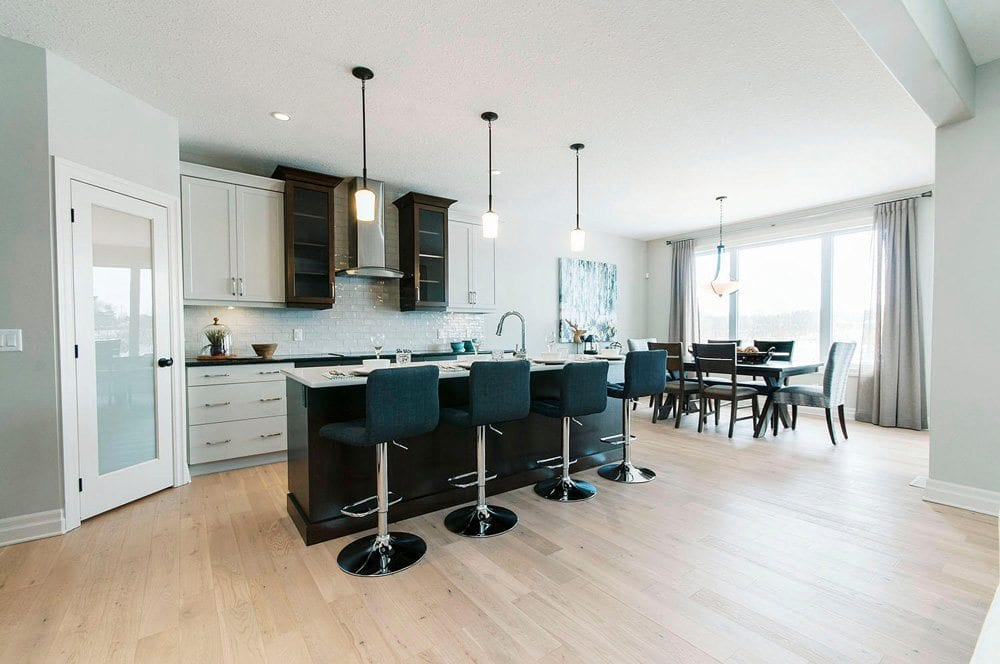 Modern kitchen with breakfast bar seats and hanging lights